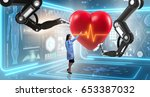heart surgery done by robotic... | Shutterstock . vector #653387032