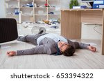 businessman dead on the office... | Shutterstock . vector #653394322