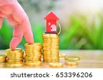 house key on top gold  coins...   Shutterstock . vector #653396206
