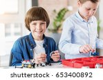 cheerful smiling male child... | Shutterstock . vector #653400892