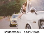 car woman happy in old retro... | Shutterstock . vector #653407036