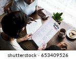 hands holding wedding planner... | Shutterstock . vector #653409526