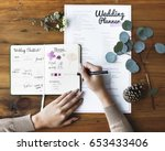 hands checking on wedding... | Shutterstock . vector #653433406