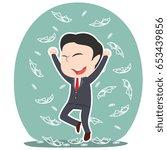 asian businessman raining money | Shutterstock . vector #653439856