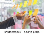 business people post it notes... | Shutterstock . vector #653451286