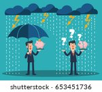 business man with umbrella... | Shutterstock .eps vector #653451736