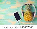 pineapple with headphones and... | Shutterstock . vector #653457646