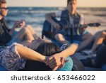 group of friends with guitar on ... | Shutterstock . vector #653466022