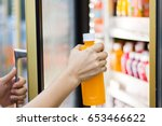 woman's hand open convenience... | Shutterstock . vector #653466622