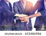 business people joining hands... | Shutterstock . vector #653486986