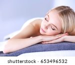 young woman lying on a massage... | Shutterstock . vector #653496532