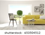 white room with sofa and green... | Shutterstock . vector #653504512