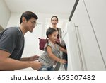 happy family loading clothes... | Shutterstock . vector #653507482