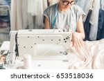 young woman sewing with sewing... | Shutterstock . vector #653518036