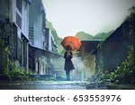 mysterious woman holds orange... | Shutterstock . vector #653553976