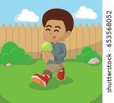 african boy eating ice cream | Shutterstock .eps vector #653568052