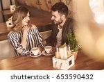 young couple during meeting in... | Shutterstock . vector #653590432