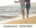 legs of couple on the sand beach | Shutterstock . vector #653615842
