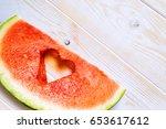 watermelon slice with cut in... | Shutterstock . vector #653617612