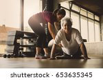 older women doing pushups.... | Shutterstock . vector #653635345