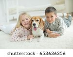 happy children with dog | Shutterstock . vector #653636356