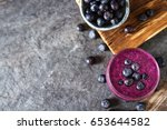 fresh juicy blueberry smoothies ... | Shutterstock . vector #653644582