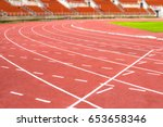 red running track on athletic...