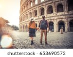 young couple at the colosseum ... | Shutterstock . vector #653690572