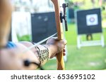 person is shooting with bow on... | Shutterstock . vector #653695102