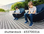two kids with tablet and phone... | Shutterstock . vector #653700316