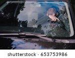 young man fall asleep in a car | Shutterstock . vector #653753986