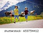 happy children walking on a... | Shutterstock . vector #653754412