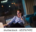 young businessman using mobile... | Shutterstock . vector #653767492