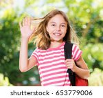 smiling girl 10 11 year old... | Shutterstock . vector #653779006