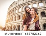 young couple at the colosseum ... | Shutterstock . vector #653782162