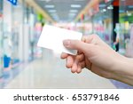 payment card in hand . | Shutterstock . vector #653791846
