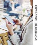 woman sitting in coffee shop... | Shutterstock . vector #653796385