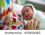 arabic muslim mother carrying... | Shutterstock . vector #653826382