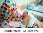arabic muslim mother carrying... | Shutterstock . vector #653826592