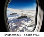 Small photo of Airplane window. Bird's-eye.Traveling.