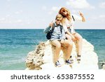 the elder sister with her... | Shutterstock . vector #653875552