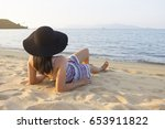 women lying on the beach at... | Shutterstock . vector #653911822