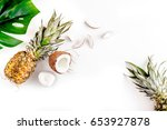 sliced coconut and pineapple in ... | Shutterstock . vector #653927878