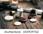sewing accessories on wooden | Shutterstock . vector #653929762
