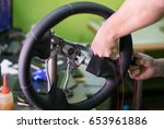 the mechanic change a new cover ... | Shutterstock . vector #653961886