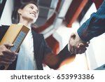 business people shaking hands.... | Shutterstock . vector #653993386