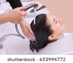 the hairdresser washes the... | Shutterstock . vector #653994772