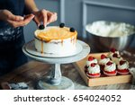 pastry chef in the kitchen... | Shutterstock . vector #654024052