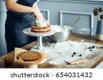 making cake in kitchen | Shutterstock . vector #654031432