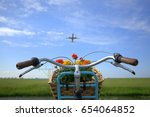 A Bicycle With Flowers In A...